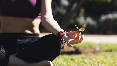 Butterfly-on-meditating-woman